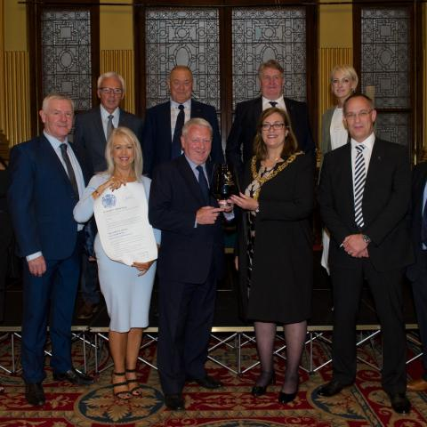 Image of The Lord Provost of Glasgow presenting the Queens Award to Cruden Staff, as part of the City Legacy Homes Consortium