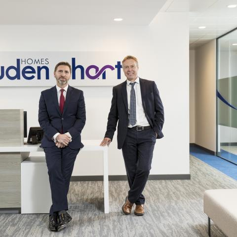 Steven Simpson (left), managing director of Cruden Homes (East) Ltd and Colin Macdonald, managing director of Hart Builders at the new Cruden House reception.