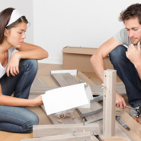 Couple assembling flat pack furniture