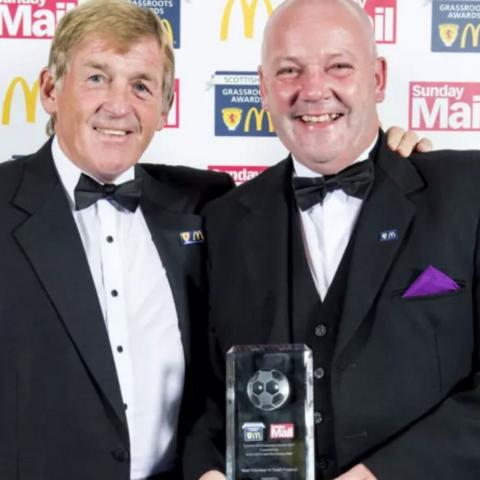 Phil Purves accepting his 2017 Scottish FA Grassroots Award from Kenny Dalglish