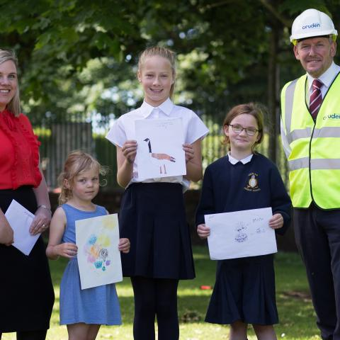 Cruden Homes' sales and marketing director, Hazel Davies, competition runner-up, Ella, competition winner, Lotte, competition runner-up, Abigail and Cruden Homes' contracts manager at the Meadowside development, Andy Brown, at the prize giving presentation held recently at Aberlady Primary School.