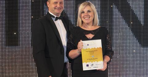 Hazel Davies, sales and marketing director of Cruden Homes collecting award for Large Housing Development of the Year at Scottish Homes Awards